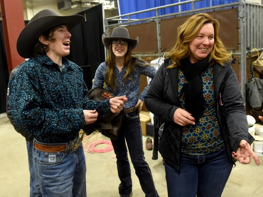 The Kennard family, from left: Christian, 17, Anagrace, 14, and their mother Donna, share a laugh before the two siblings participate in this past weekend's rodeo competition at the Pa. Farm Show in Harrisburg on Friday, Jan. 5, 2018.