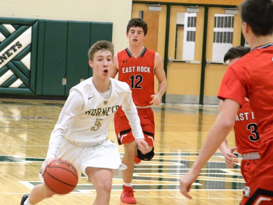 Garrick Welch (5) and the Wilson Memorial Hornets are