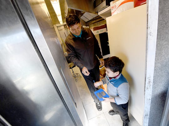 Gio Castro Hernandez talks with his four-year-old son,