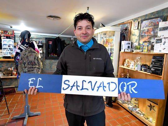 Gio Castro Hernandez stands inside a business he owns