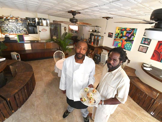 Jerome Dericho and Sunqeet Pepper pose for a photographer earlier this year at their restaurant in downtown Staunton.