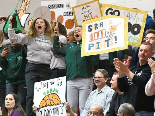 Fans celebrate after Wilson Memorial's Sarah Sondrol scores her 1,000 point during a game against Riverheads, played in Greenville on Thursday, Jan. 18, 2018.