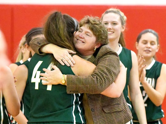 Wilson Memorial head coach Jackie Bryan hugs player Sarah Sondrol who just scored her 1,000 point during a game against Riverheads, played in Greenville on Thursday, Jan. 18, 2018.