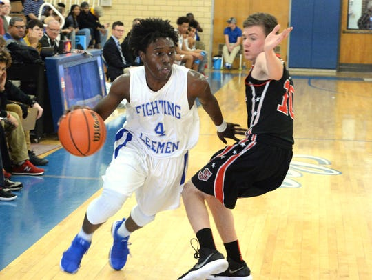 Lee High's Jahleel Pettiford tries to get around a