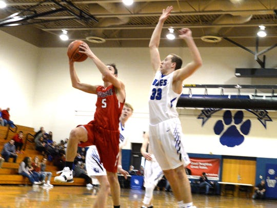 Riverheads' Zack Adams tries to avoid Parry McCluer's