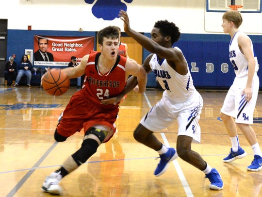 Riverheads Grant Painter drives around a Parry McCluer