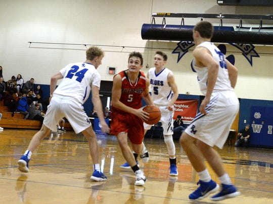 Riverheads' Zack Adams drives through the Parry McCluer defense Saturday at Rockbridge County High School.