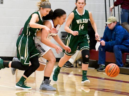Stuarts Draft's Monique Ayres races a Wilson Memorial player as the chase after a loose ball during a basketball game played in Stuarts Draft on Tuesday, Jan. 30, 2018.