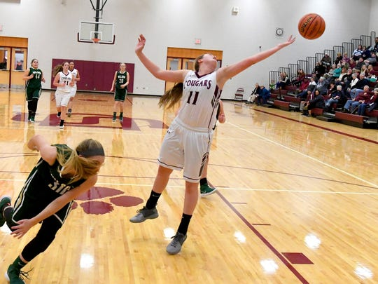 Stuarts Draft's Hadley May reaches after the ball as the rebound slips past during a basketball game played in Stuarts Draft on Tuesday, Jan. 30, 2018.