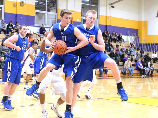 Fort Defiance's Zach Eppard (11) comes down with a