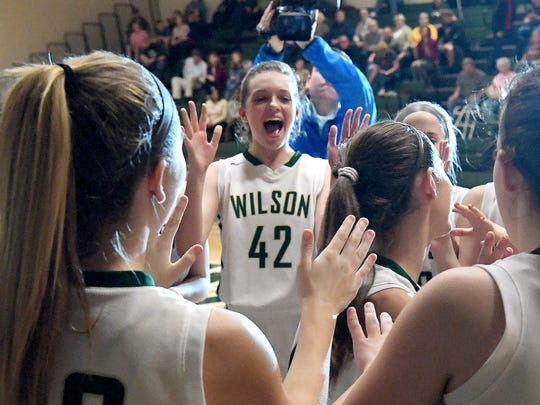 Wilson Memorial's Eliza Dana cheers as the players are introduced before the start of their the Shenandoah District girls basketball championship game against East Rockingham, played in Fishersville on Thursday, Feb. 15, 2018.