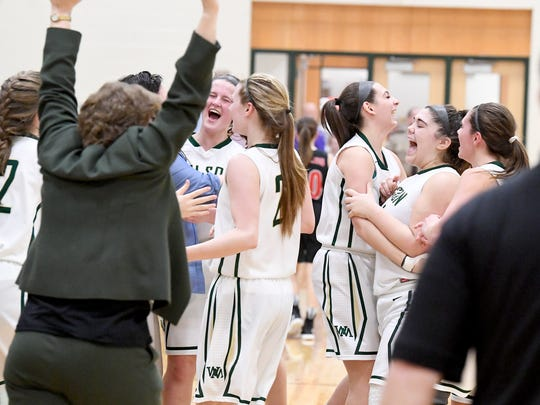 Wilson Memorial celebrates their winning the Shenandoah District girls basketball championship game against East Rockingham, played in Fishersville on Thursday, Feb. 15, 2018.