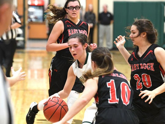 Wilson Memorial's Sam Kershner finds herself surrounded by East Rockingham players as her team tries to burn seconds off the clock in the final minutes of the Shenandoah District girls basketball championship, played in Fishersville on Thursday, Feb. 15, 2018.