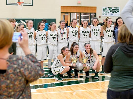 Wilson Memorial comes together as a team for photos, celebrating their winning the Shenandoah District girls basketball championship game against East Rockingham, played in Fishersville on Thursday, Feb. 15, 2018.
