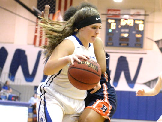 Fort Defiance's Calin Wright works to get around a