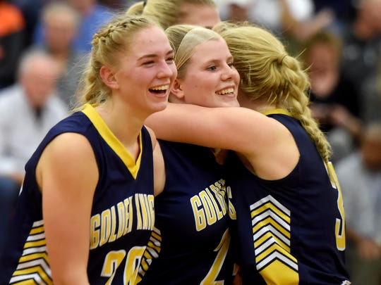 Eastern York's Morgan Winter, center, is all smiles after hitting a three pointer to put her team within striking distance of York Suburban during the the Class 4A tournament on Tuesday, Feb. 20, 2018. The Knights took it to the last seconds during their 43-40 loss.
