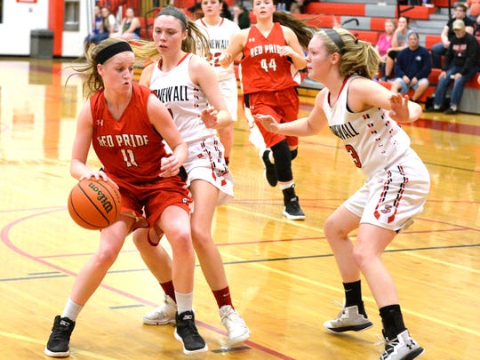 Riverheads' Sara Moore dribbles against a pair of Stonewall Jackson defenders Wednesday in the Region 1B semifinals. Stonewall won 55-50.