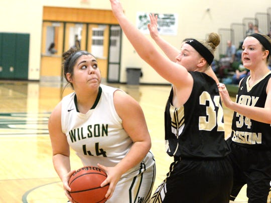 Wilson Memorial's Sarah Sondrol looks for a shot against Buffalo Gap's Alexis Clark (32) and Brittany Hanger (34) Thursday in the Regional 2B semifinals.