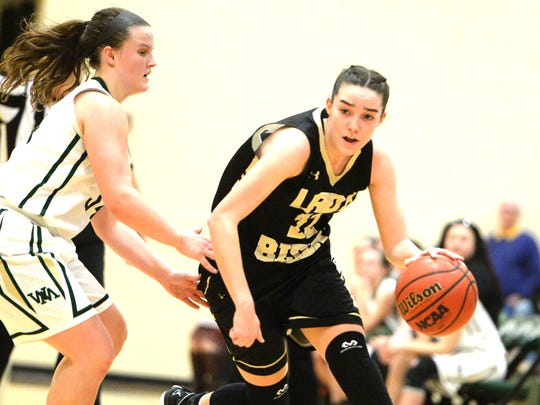 Buffalo Gap's Leah Calhoun, who finished with 15 point Thursday in a win over Wilson Memorial, works to get around Wilson's Cheridan Hatfield.