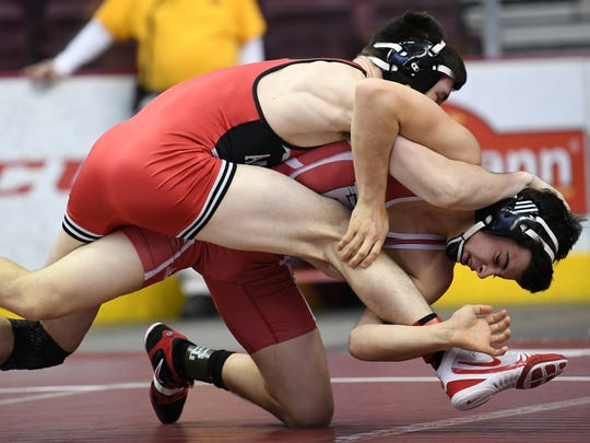Annville-Cleona's Zachary Renninger holds a temporary advantage over Pequea Valley's Gabe Miller during Zachary's loss in the quarterfinals of the AA District 3 championships in Hershey on Friday, Feb. 23, 2018.