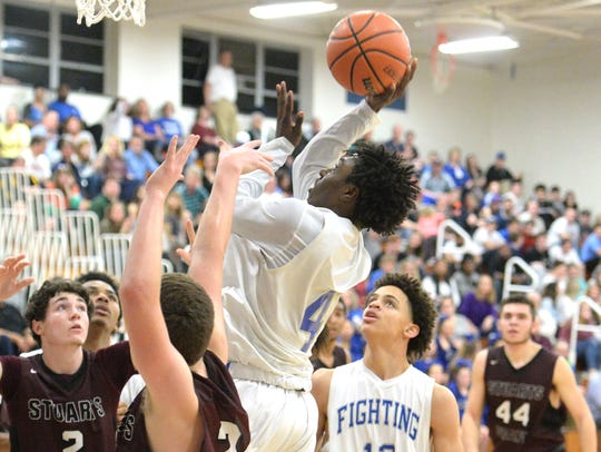 Lee High's Jahleel Pettiford shoots over the Stuarts