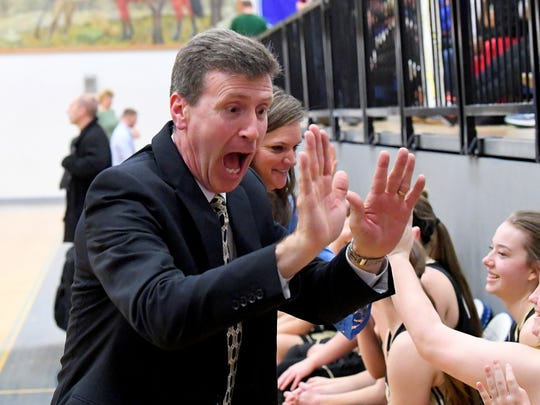 Buffalo Gap head coach Phillip Morgan celebrate their winning the Region 2B girls basketball championship with his players after they defeat George Mason in a game played in Penn Laird on Saturday, Feb. 24, 2018.