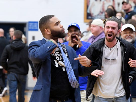 """Robert E. Lee's Terrell Mickens, the 2018 All-City/County Boys Basketball Coach of the Year, points to a T-shirt emblazoned with the words, """"Crying Tears of Joy"""" he wore during the Leemen's win over Central-Woodstock in the VHSL Region 2B championship game played in Penn Laird on Saturday, Feb. 24, 2018."""
