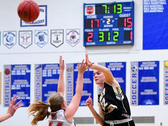 Buffalo Gap's Leah Calhoun goes high to pass the ball overtop several George Mason players during the Region 2B girls basketball championship game played in Penn Laird on Saturday, Feb. 24, 2018.