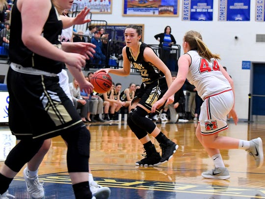 Buffalo Gap's Leah Calhoun moves the ball as George Mason's Madeline Lacroix guards during the Region 2B girls basketball championship game played in Penn Laird on Saturday, Feb. 24, 2018.