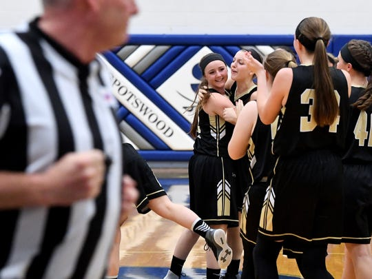 Buffalo Gap players celebrate their winning the Region 2B girls basketball championship after defeating George Mason in a game played in Penn Laird on Saturday, Feb. 24, 2018.