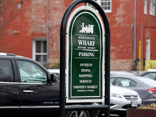 A sign marks the Wharf parking lot in Staunton.