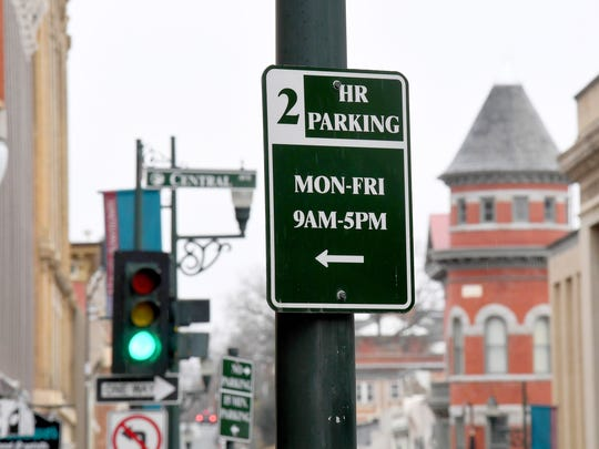 A sign marks 2-hour parking along West Beverley Street in downtown Staunton.