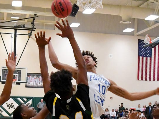 Robert E. Lee's Jarvis Vaughan battles for the rebound