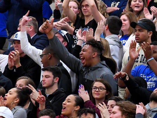 Robert E. Lee fans cheer as their team takes the lead
