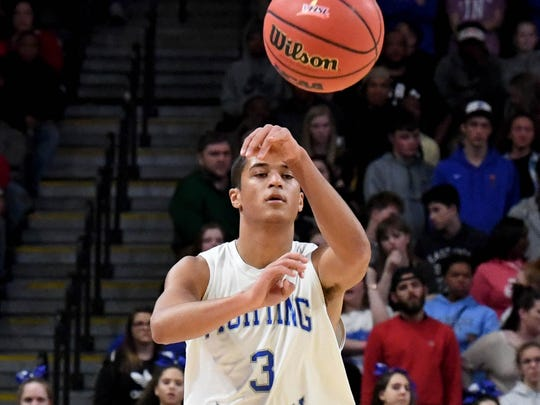 Robert E. Lee's Jayden Williams passes the ball during the VHSL Class 2 boys state championship game played in Richmond on Friday, March 9, 2018.