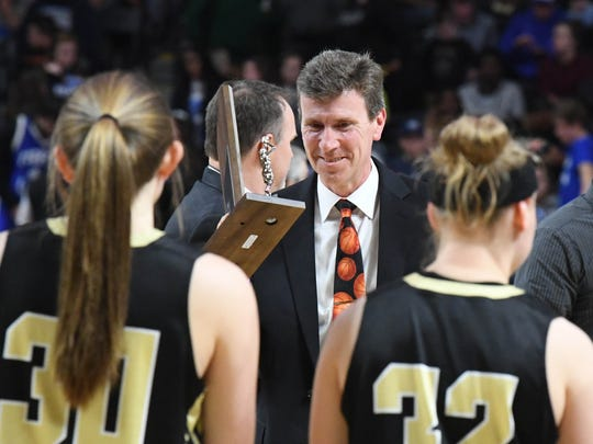 Buffalo Gap head coach Phillip Morgan brings the runner-up trophy back to his players, still with a smile, after they fall to Central-Wise in the VHSL Class 2 girls state championship game played in Richmond on Friday, March 9, 2018.