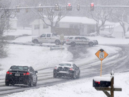 Snow falls as vehicles with the Augusta County Sheriff's