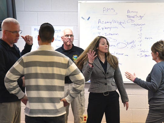 CIT trainer Becky Meeks plays a variety of people in crisis during role-play scenarios at a weeklong training session in Staunton this March.