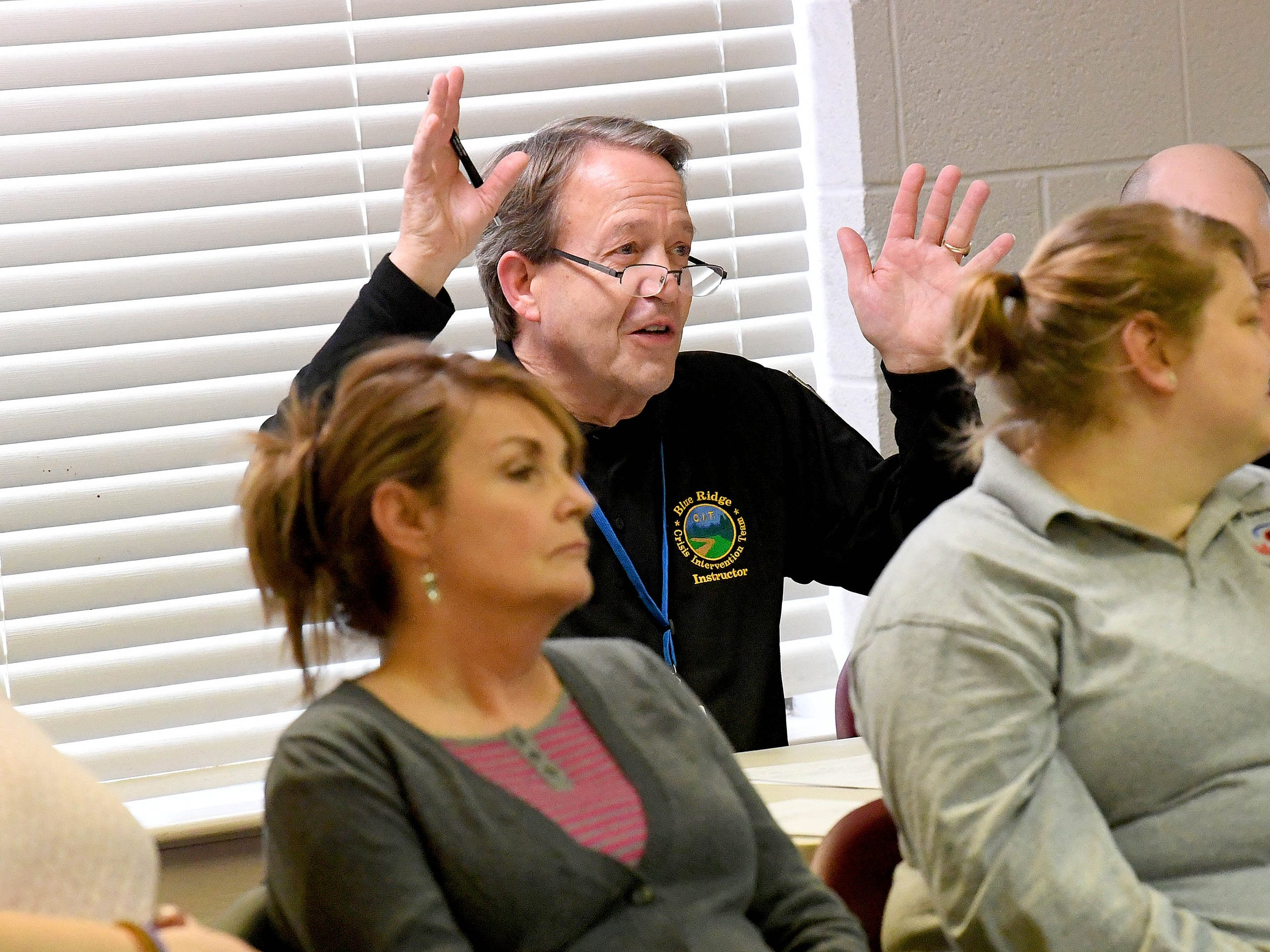 Robert Tucker, assistant director of behavioral health with Valley Community Services Board and CIT trainer, voices his observations to students who just finished trying to deescalate a crisis situation as part of roleplaying exercise during Crisis Intervention Team (CIT) training held in Staunton on March 7, 2018.
