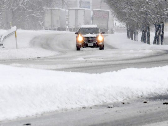 A car travels along U.S. 250 near Staunton during a
