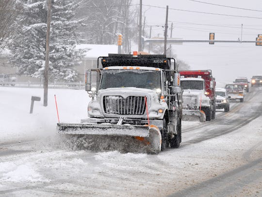 Snowplows work in tandem to clear U.S. 250 in Fishersville