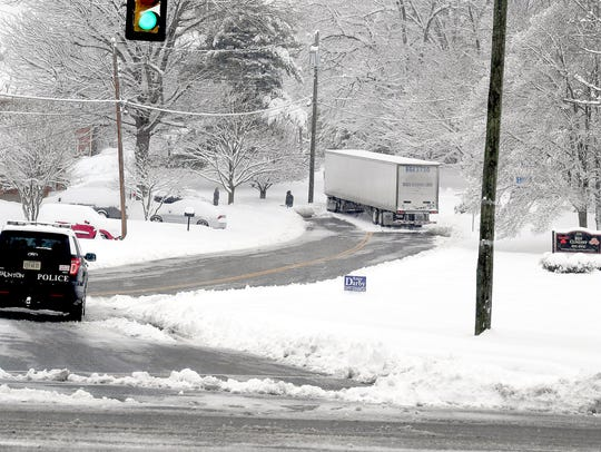 A truck is stuck in the snow on Edgewood Road in Staunton