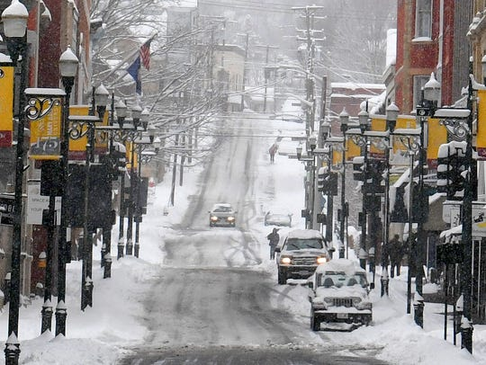 Looking down Beverley Street during a spring snow storm