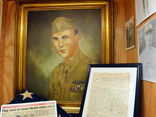 A painting of Maj. Thomas D. Howie hangs in a display with other items related to him at the 116th Regiment Museum in Verona.