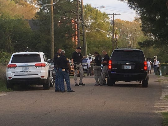 Hattiesburg police officers conduct a death investigation