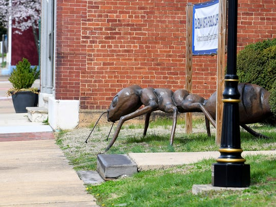 A much larger-than-life ant, created by artist Mark Cline, crawls around on the ground as one of just over a dozen such visible in downtown Buena Vista on Sunday, April 1, 2018. They are part of Cline's annual April Fool's creation and should remain on display for the next several months.