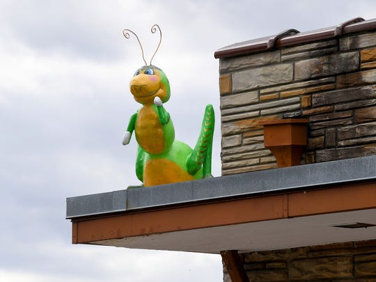 A much larger-than-life insect, created by artist Mark Cline, adorns a rooftop as one of just over a dozen such visible in downtown Buena Vista on Sunday, April 1, 2018. They are part of Cline's annual April Fool's creation and should remain on display for the next several months.