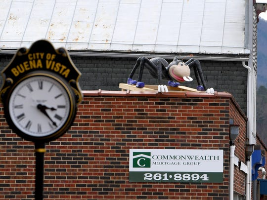 A much larger-than-life spider, created by artist Mark Cline, overlooks the street below as one of just over a dozen such creations in downtown Buena Vista on Sunday, April 1, 2018. They are part of Cline's annual April Fool's creation and should remain on display for the next several months.