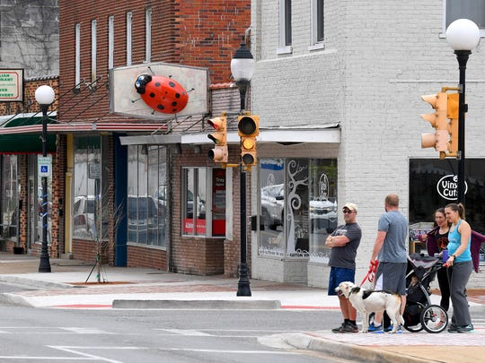A much larger-than-life ladybug, created by artist Mark Cline, crawls across a business sign as one of just over a dozen such visible in downtown Buena Vista on Sunday, April 1, 2018. They are part of Cline's annual April Fool's creation and should remain on display for the next several months.