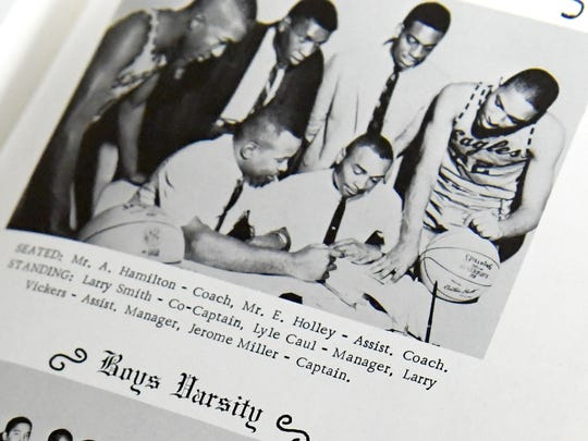 Basketball coaching staff pictured in a 1965 yearbook for Booker T. Washington High School.